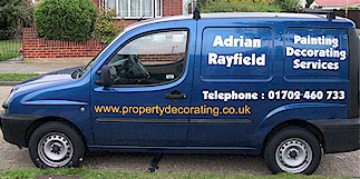 Image of blue van with sign writing