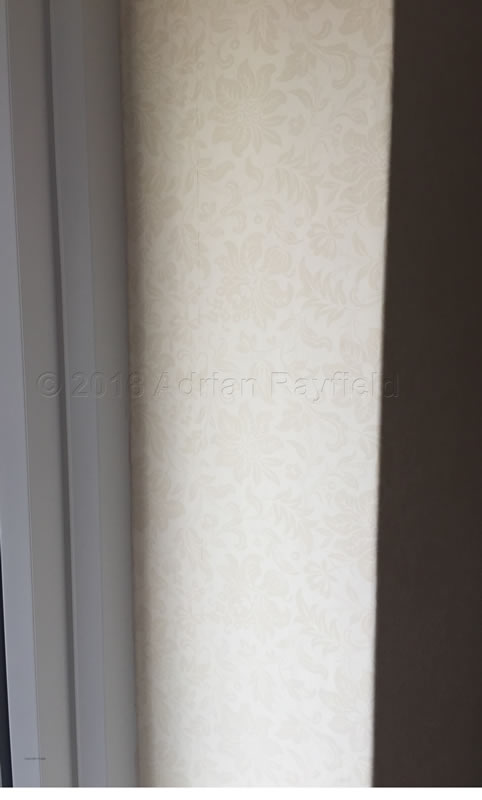 Finished job with wallpaper around window
